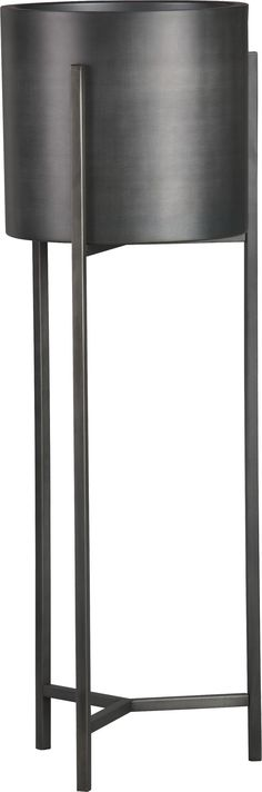 """Handcrafted iron planters with warm antiqued bronze finish are framed inside an architectural stand with slender legs and tripod crossbar supports. 100% ironAntique bronze finishAccommodates a 9"""" pot (no drainage opening)For indoor or outdoor useMade in India."""