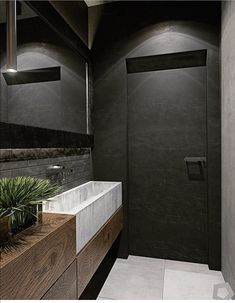 Have an exposed brick wall? Make the most of it by pairing it with wooden panelling and grey fixtures. These three inspirational interiors show you how. Decoration Inspiration, Bathroom Inspiration, Modern Bathroom Design, Bathroom Interior Design, Ideas Baños, Toilette Design, Wooden Panelling, Interior Doors For Sale, Futuristisches Design