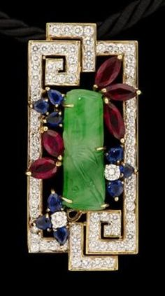 18 karat yellow gold diamond pendant with jade. Asian Art Deco motif pendant set with a frame of seventy-eight petite circular cut diamonds centring on a carved jade bamboo shoot accented by marquise cut rubies and sapphires.