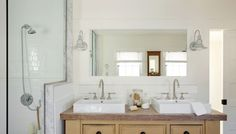 Placed in the first bathroom (shown above) is the Barn Light Montana Sconce. The pair of galvanized wall lights are mounted on opposite sides of the mirror and dual sinks. The Montana Sconce was a superb choice for the rustic bathroom, which repurposed an old dresser as a vanity.
