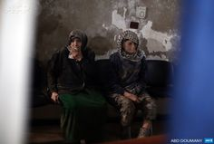 SYRIA, Douma : An elderly Syrian couple await treatment at a makeshift clinic in the besieged rebel town of Douma, 13 kilometres (eight miles) northeast of Damascus, on December 21, 2014. AFP PHOTO/ ABD DOUMANY