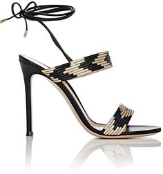 """Gianvito Rossi GIANVITO ROSSI WOMEN'S SUNI ANKLE-TIE SANDALS-BLACK SIZE 7.5 Styled with wraparound ankle ties, Gianvito Rossi's Suni sandals are crafted of black and metallic gold chevron-pattern piped leather. 4""""/100mm heel (approximately). Open toe. Toe band. Instep strap. Leather-covered stiletto heel. Black round leather laces. Ankle-tie closure. Lined with smooth leather. Leather sole. Available in Black/Gold. Made in Italy."""