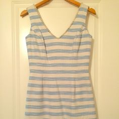 Never worn Lilly Pulitzer striped dress Never worn, blue and white striped Lilly Pulitzer dress. Hits just above the knee. Pearl beading around the neckline. Lilly Pulitzer Dresses Midi