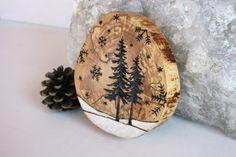 """Winter Wonderland Series ~ Woodland Nature Art  by TwigsandBlossoms, $30.00 ~ """"This lovely spalted wood round has a woodland winter wonderland scene burnt into the wood and details have been added with white paint. These beautiful rounds are about 4 inches across and 3/4 inch thick and fell naturally. Each one is a perfect work of art! Sealed and a small hole has been drilled into the back for easy wall hanging on a small nail. Signed and dated on the back."""""""