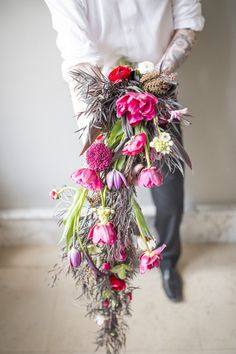 Beautiful and wildly unique floral bouquet by Feisty Flowers in Milwaukee, photographed by Twin Lens Weddings at Charles Allis Art Museum #weddingbouquet #bouquet #weddingflowers #weddinginspiration #bohobride #twinlensweddings