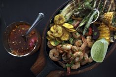 HAVANA, CUBA - DECEMBER 18: A plate of prawns, grilled vegetables and tomato salsa at 304 O'Reilly, a trendy restaurant serving upscale traditional Caribbean cuisine and cocktails on December 18, 2015 in Havana, Cuba. Sited in the center of ciudad vieja Habana, or Havana's old city, the restaurant is popular with the tourists and up-and-coming Cubans alike. (Photo by David Silverman/Getty Images)