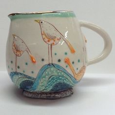 Mini milk . Simple birds riding the waves. ( little rock propping it up) I'm enjoying this jug shape. ------------------------------------------ #ceramics #keramica #illustration #sgraffito #bird #birds #jug #milk #milkjug #waves #texture #orange #isthatonedead? #notsure #sleepytimebird #curvey #creamer #pottery #goingouttoamultimediaevent #whatsthatanyway?