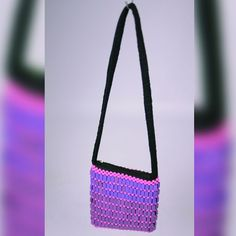 Sebaga is a setswana word which means beads. This trendy Sling Bag is made with colourful crystal beads. Comes with a comfortableshoulder strap for hassle-free carrying . The bag has an internal zip to store either your coins, cards or less bulky keys sets. The strap is approximately 40cm long; while the bagmeasures 25cm x 17.5cm.Please note that no returns, exchanges can be made after 30days unless in the case of a factory fault.