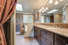 Check out this newly remodeled bathroom with dual vanity mirror and glass shower. Make this dream your reality! (480) 625-0704 #framelessglass #phoenix #dualvanity #framelessmirror #remodeledbath