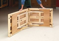Lightweight and portable, this handy folding table is also tough enough to hold a heavy load. Garage Workbench Plans, Portable Workbench, Woodworking Workbench, Woodworking Projects Diy, Folding Furniture, Built In Furniture, Wood Furniture, Modern Folding Tables, Folding Picnic Table