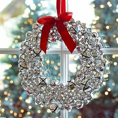 Silver bells Christmas wreaths. The wreath looks very fresh and elegant with the silver and white color combination and the bright red ribbon accents simply helps make the wreath stand out.