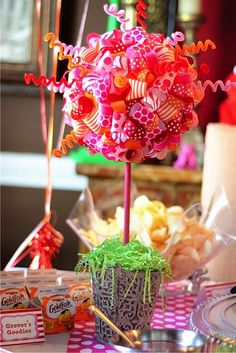 Make a ribbon centerpiece by pinning/gluing ribbon loops and pipe cleaner to a foam ball.