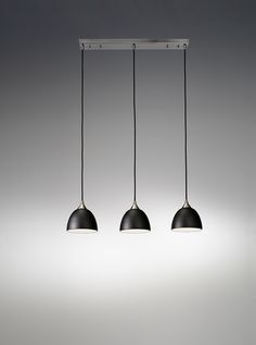 FL2290/3/930 Vetross 3 light pendant on a bar. Black glass with gold interior, Satin Nickel fitting with black cord suspension. 3 x 40w E27 Lamps not included Height- 113cm Minimum Height- 33cm Width- 80cm BRAND: Franklite REFERENCE: FL2290/3/930 AVAILABILITY: 3-4 Working Days