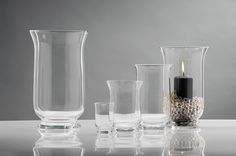 See our range of Glass Hurricane Lamps for pillar candles. they look great with sand & pillar candle inside! Glass Hurricane Lamps, Garden Candles, Lantern Lamp, Wood Candle Holders, Oil Lamps, Carafe, Wood And Metal, Pillar Candles, Clear Glass