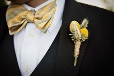 Photo: StyleMePretty.comThis gorgeous wheat and yellow craspedias boutonniere reminds me of a rustic country wedding with mason jar …