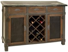 This wine storage sideboard offers rustic elegance...  A Classic!!!   Ground your dining room's classic style with our Dolcetto Wine Cabinet. Featuring a distressed grey frame, natural wood finish drawers, metal door fronts and metal hardware, this buffet is a work of art.  -Holds eight standard-size bottles of wine.  -Three drawers and two doors for storing linens, dishes, wine accessories and more.
