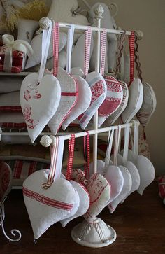 Hearts in my workroom - lavender filled heart pillows using vintage & antique textiles, ribbons and buttons | Flickr - Photo Sharing!