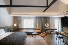 Design firm Asylum has converted a former spice warehouse on the Singapore River into a hotel, featuring brickwork walls and mid-century style furniture.