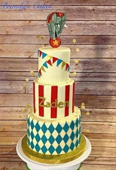 Vintage, circus themed, birthday cake done in buttercream with hand drawn elephant topper.  Cake by Brandy's Cakes in Weatherford, TX.