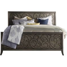 Give your master suite or guest room a fashion-forward look with this sophisticated bed, showcasing a contemporary swirl design and metallic finish.