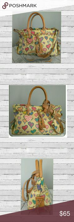 "👜🌻🌻Authentic Dooney & Bourke Hearts Tassel Tote 👜🌻🌻Beautiful Authentic Dooney Bourke Signature Hearts Tassel Tote bag Very Minor wear Good Condition  See Photos  D&B bag with Leather Handles Shoulder Crossbody Strap Pink Enamel Heart Charm In Classic Colorful crayon - inspired Heart Pattern. Measure 12""W X 5"" D X 7"" H Strap Drop 20"" 🌷Please Don't Forget Posh Takes 20%🌷  🛍 Bundale 3  items & Save 15% 👍Make an Reasonable  Offer  Have any questions feel free to ask before purchasing…"