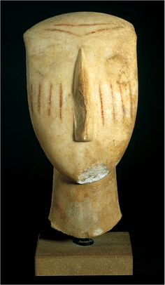 Cycladic Head with painted facial tattoos - Cycladic Islands, Marble, Early Bronze Age (3200 - 2000 BC). Scratch marks / tattoos are sometimes found on face and are thought to be a sign of mourning.