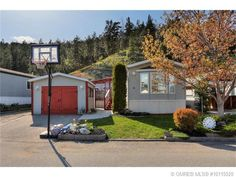 For more pictures, visit www.jennifer_black.com. Modern 3bed+addition home backing onto green-space and short stroll to beach. Vaulted ceilings, vinyl plank flrs, large deck, 2ba, single garage, private yard w/water features, green house and storage shed.
