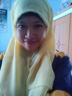 Yellow hijab in purple uniform