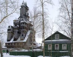 """Wooden Gangster House. Archangelsk, Russia. Amazing, the eighth wonder of the world, made out of wood, by a Russian Gangster who only ever intended to build a normal looking normal sized house. He didn't really like the way it looked after building the first couple of floors so he kept on building. """"What you see today is a happy accident"""" he said..."""