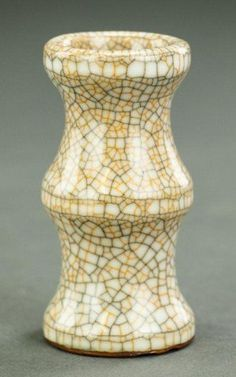CHINESE ANTIQUE GE WARE SMALL VASE Bone colored ground with orange and black crackleware. In the style of the Ming period. H: 3 7/8 in.
