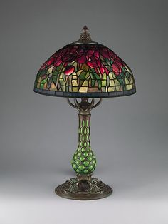 "Tiffany Studios, New York, Favrile Leaded Glass and Patinated Bronze ""Tulip"" Lamp."