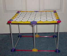 Hi I built this knex bedside table because am fed up of stuff lying on the floor andcleaning my room was freaquent. So I built this and it is sturdy ...