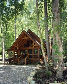 Cabin- love the roof was extended over the porch. smart!