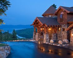 Mountain home built on a tight knoll with killer lake and mountain views
