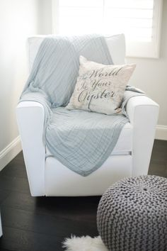 "Glider w/blue blanket. ""World is your oyster"" pillow w/gray poof for door rest. chair floor pillow Los Angeles Home Tour Travel Theme Nursery, Nursery Themes, Nursery Ideas, Room Ideas, Relax, Blue Blanket, Los Angeles Homes, Nursery Neutral, Nautical Nursery"