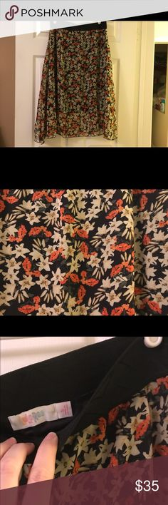 Lularoe small Lola Small Lola. Black background with creams, oranges and greens. Like new LuLaRoe Skirts Midi