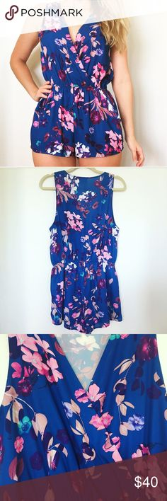 Nasty Gal Blue Floral Romper Nasty Gal Blue Floral Romper with pockets. Size Medium. Worn three times. Last picture shows slight pull in front from pinning bust close, not noticeable when worn Nasty Gal Other