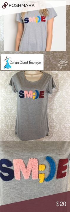 NEW Boutique!  Super Cute Tee with Textured SM;)E Gray Heather T-Shirt.  Relaxed Fit.  SM;)E graphics is textured application.  Sweet Claire.  No offers on Boutique items please.  Bundle discount can help you save!   Thanks for shopping my boutique! Tops Tees - Short Sleeve