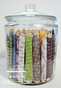 DIY Organization - Store ribbon in inexpensive glass containers. Each piece of ribbon is wrapped around a wide popsicle stick.Frugal Friday: 25 DIY Organization Ideas - One Good Thing by JilleeClever idea for ribbon storage DIY. I'm just going to do