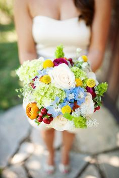 love the colours in this bouquet - especially against the cream bridesmaid dress