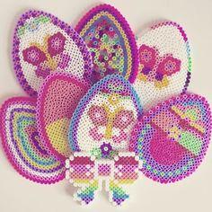 Easter eggs hama beads by livresetmerveilles Pony Bead Patterns, Pearler Bead Patterns, Perler Patterns, Pearler Beads, Fuse Beads, Beading Patterns, Melted Bead Crafts, Christmas Perler Beads, Art Perle