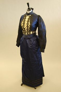 a navy silk and black lace gown, Ca.1897