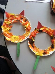 Adorable Lion masks I made with my class. Cut out the center of a paper plate, have the children paint the plate with orange paint mixed with glue then have them tear up tissue and put on. Add the ears and tape a popsicle stick to the back and have then stick there faces in and ROAR! My kids LOVED this!