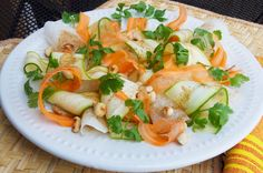 This salad is a fancy take on the popular street snacks found in Mexico. Carrots, jícama, and zucchini ribbons dressed in a tangy ancho chile vinaigrette and dotted with roasted peanuts and cilantro leaves. Recipe R, Zucchini Ribbons, Mexican Food Recipes, Ethnic Recipes, Roasted Peanuts, Spanish Food, Vinaigrette, Fresh Rolls, Soul Food