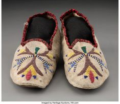 For Auction: 70571: A Pair of Santee Sioux Beaded Hide Moccasins wi (#70571) on Nov 20, 2020 | Heritage Auctions in TX Native American Moccasins, Beaded Moccasins, Sioux, Baby Shoes, Auction, Pairs, Flats, Design, Loafers & Slip Ons