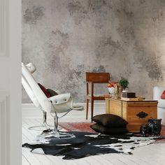 Pour un effet mur en béton texture patinée, découvrez le papier peint Patina de la collection 2 de Rebel Walls.