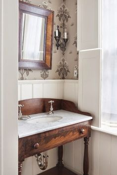 wallpaper, board and batten, old table turned sink
