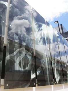 Perth Radiological Clinic, Shenton House : Glazing area features a playful montage of x-ray, while reflecting the sky l Meyer Shircore Architects l  imagesImagInked | A blog about printed glass.