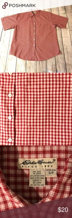 Short-sleeve Eddie Bauer red plaid shirt 100% cotton shirt from Eddie Bauer. Curved hem with small slits. Chest pocket. Fits loose and looks great as a coverup!  Chest measurement: ~24 inches flat  Length measurement: ~31 inches Eddie Bauer Tops Button Down Shirts