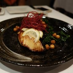 Grilled BC Wild Sablefish Yuan Zuke - 20 hour marinated in yuzu soy, kale and fried chickpeas (hard to go wrong) At Zest Japanese in Vancouver
